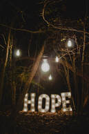 Illuminated lightbulb, and the word 'hope', illustrating previous blog theme, 'A hope-filled year'.
