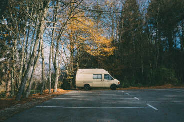 Solitary camper van in scenic carpark, illustrating the page theme, 'enjoying solitude'.