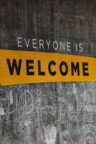 Wooden board displaying the message, 'Everyone is Welcome'.